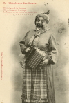Photographic Postcard of  a Comic Actor in Drag Playing a Flutina Accordion (1903)
