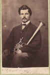 Carte de Visite of  seated portrait of man with over the shoulder cornet