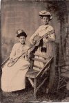 Tintype of  two ladies (possibly Spanish) holding guitar and badminton racquet,  c. 1890's