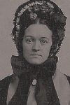 Ambrotype of  seated woman with black bonnet